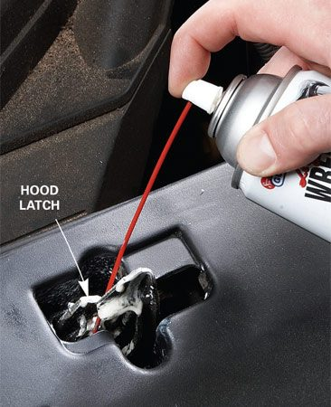 <b>Photo 3: Lube the hood latch</b></br> Spray aerosol lithium grease on the hood latch mechanism. You don't want to fight a balky hood latch when it's snowing and you're trying to add windshield fluid.