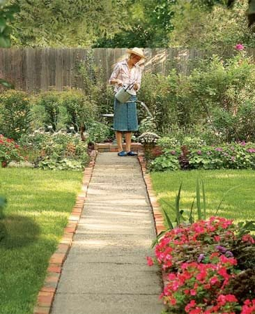 <b>Brick border</b><br/><p>A brick border adds color and charm to a bland concrete sidewalk or driveway.</p>  <p>Photo by Shawn Nielsen and Craig McNitt</p>