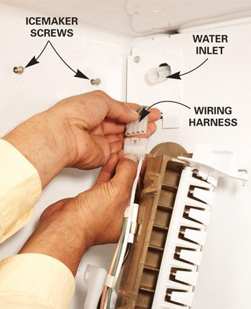 <b>Photo 2: Plug wiring harness together</b></br> Line up the wiring harnesses and plug them together before screwing the icemaker in place.