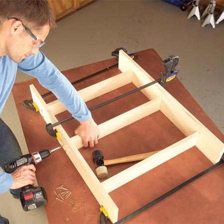 <b>Photo 2: Assemble the shelves</b></br> Clamp the shelves between the sides and screw the cabinet together. Give the exposed screw heads a neater look with finish washers.