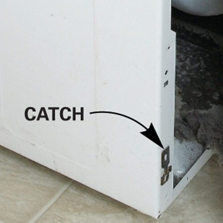<b>Photo 2A: Close-up of bottom catch</b></br> The catches make front panel removal easy.
