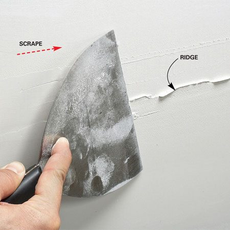 <b>Scraping a ridge</b></br> Run a 6-in. taping knife over all the joints when dry to knock off ridges. The ridges are usually there, even if you don't see them!