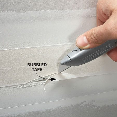 <b>Cut around bubbled area</b><br/>Completely remove all bubbled tape and remud.