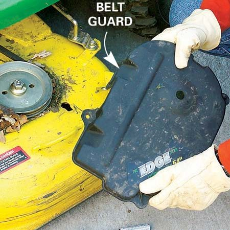 <b>Clean the mower deck</b><br/>Remove the belt guards and blow off the debris that wrecks belts and pulleys. Scrape away any debris buildup under the pulleys with a screwdriver.