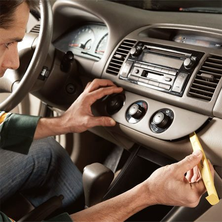<b>Photo 1: Remove the control panel</b></br> Slip the nylon prying tool between the heater control and the dash. Pop the control panel off.