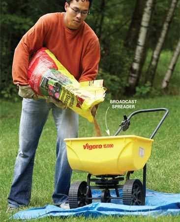 <b>Photo 1: Protect your lawn</b><br/>Spills will kill your grass. Park your spreader on a tarp or driveway when filling to avoid herbicide overdoses.