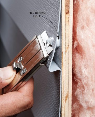 <b>Trimming the caulk</b></br> Trim the hardened caulk flush with the siding using a razor blade.