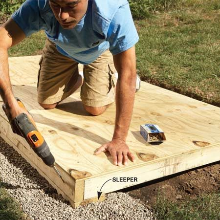 <b>Photo 2: Attach the floor</b></br> Screw the floor framing to the sleepers at each corner. Then double-check the floor for level.