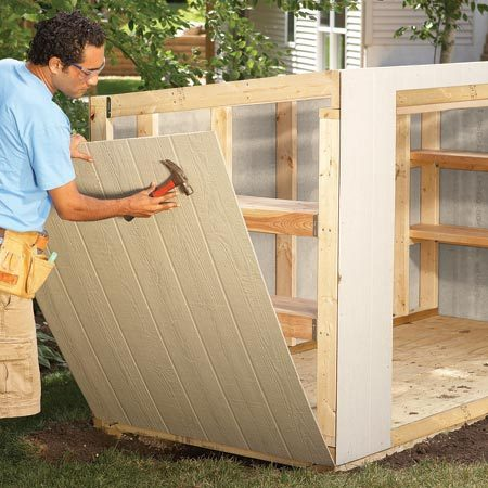 <b>Photo 6: Install the siding</b></br> Cut the fiber cement panels to size and nail them up.