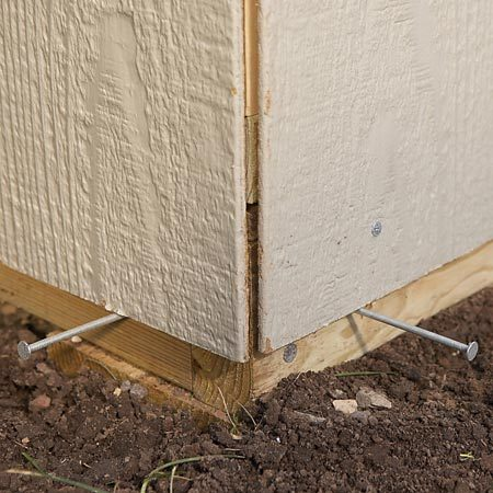 <b>Photo 6A: Close-up of panel corner</b></br> Support the heavy siding panels with temporary nails placed 1-1/2 in. from the bottom of the floor framing.