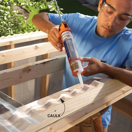 <b>Photo 8: Add the roof panels</b></br> Lay a heavy bead of caulk over the plug strip before screwing on the roof panel.
