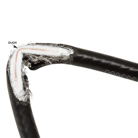 <b>Kinked cable</b></br> When coax cable kinks, the center wire crushes its foam jacket and gets too close to the shielding. That leads to interference.