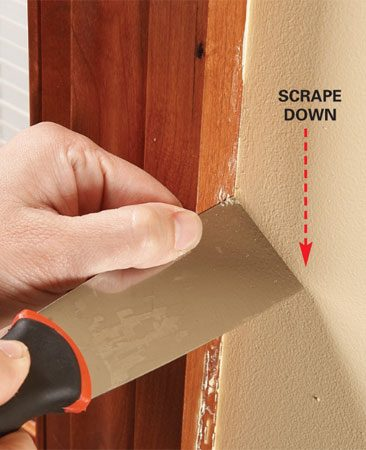 <b>Photo 1: Use a paint scraper</b></br> Drag the edge of the paint scraper across the old paint, angling it so it doesn't dig into the wood.