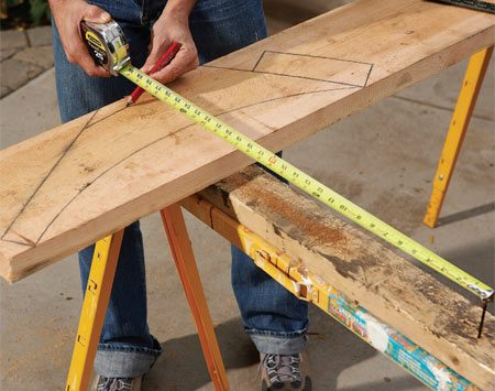 <b>Photo 3: Draw the arcs</b></br> Draw perfect curves fast using a tape measure to guide your pencil. Cut out the bracket and use it as a pattern for the other bracket.