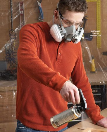 <b>Protect yourself and the work area</b></br> <p>Spraying is fast  and gives a smooth   finish, but it  also creates a fine mist   of solvent and  finish that drifts and   settles on  everything in sight and is   dangerous to  breathe. To avoid   problems, work  outdoors if possible.   If you spray  indoors, cover everything   with plastic  sheeting or drop   cloths and wear  a respirator fitted   with organic  vapor filters, especially   if you're  spraying lacquer. Also put   an exhaust fan  in the window. Read   the label on the  spray can for additional   safety precautions. </p>