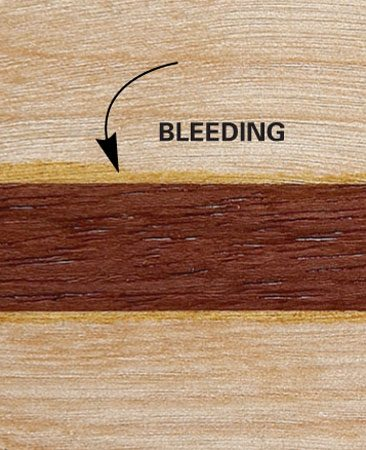<b>Bleeding wood closeup</b></br> Dark, oily woods or stains can bleed into lighter wood.
