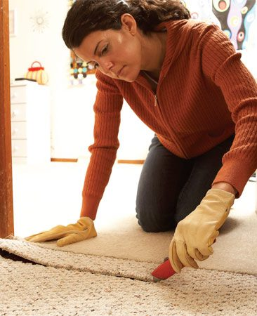 <b>Photo 2: Leave transitions for the installer</b></br> Leave transitions alone. Cut the carpet a few inches from where it meets other flooring and let the installer tackle the transition work.