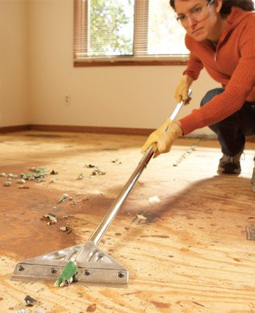 <b>Photo 3: Scrape off staples</b></br> Get rid of carpet pad staples fast with a floor scraper. If the blade digs into the wood, scrape from a low angle.