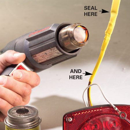 <b>Photo 2: Seal the insulation</b></br> Slide the inner tubes over the splice and shrink with a heat gun. Repeat with the outer tubes. Coat the ends with liquid electrical tape.