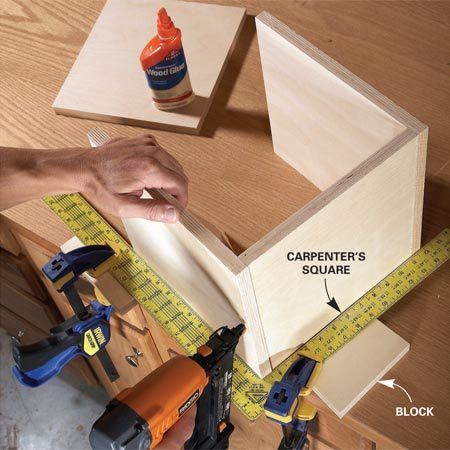 <b>Photo 2: Fasten the sides</b></br> Build perfectly square boxes by assembling them against a carpenter's square. Drive three nails per corner to hold them together until the glue dries.