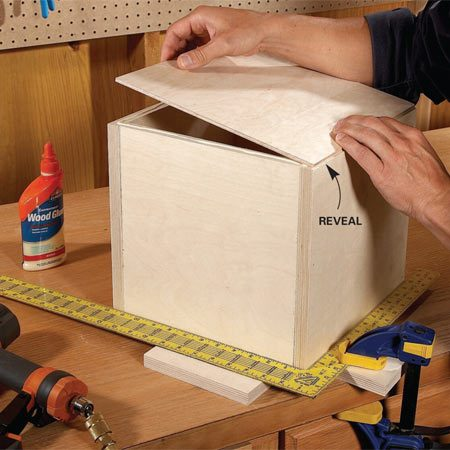 <b>Photo 3: Attach the back</b></br> Center the back panel over the box, leaving a small gap along each side. Glue and nail the panel into place. The back panel keeps the box square.