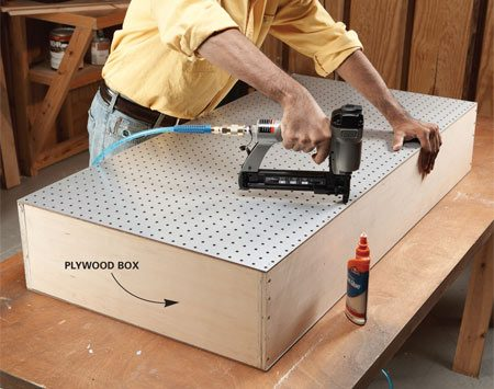 <b>Photo 1: Glue and nail the box together</b><br/>Build a simple box and cover both sides with pegboard. Remember to face the good side of the back pegboard to the inside of the box.