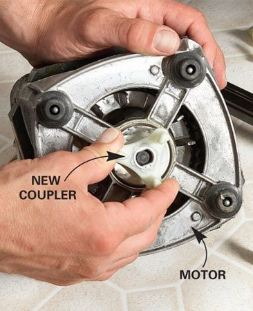<b>Replace the broken coupler</b></br> Pop the bottom retainer off the motor and prop up the motor while you pop the top retainer (it's heavy). Pry the broken coupler pieces off the motor and transmission. Tap the new coupler into place with a wooden block.