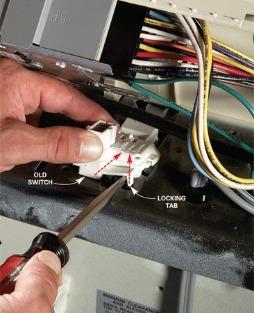 <b>Replace the lid switch</b></br> Remove the lid switch on a Maytag-type washer by prying up the locking tab and sliding the switch forward. To install the new switch, just set it in the slot and pull it backward.