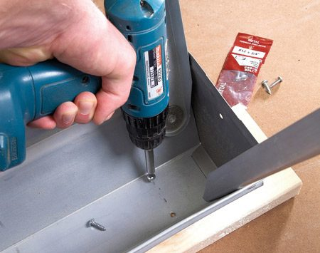 <b>Install cap boards</b></br> Fasten 2x6s to the sawhorse tops with sheet-metal screws. Screw from the underside.