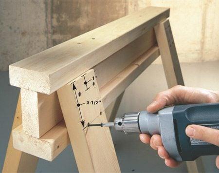 <b>Attach the legs</b></br> Attach the legs to a simple 2x4 I-beam using 3-in. screws.