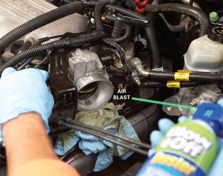 <b>Dry off the solvent</b><br/>Shoot compressed air into the throttle body to dry the spray solvent. Reinstall the ductwork and attach the vacuum lines and electrical connectors.