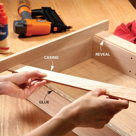 <b>Photo 2: Glue and nail the casing</b></br> Add casing to the box using as few nails as possible. Three nails will hold the casing tight while the glue dries.