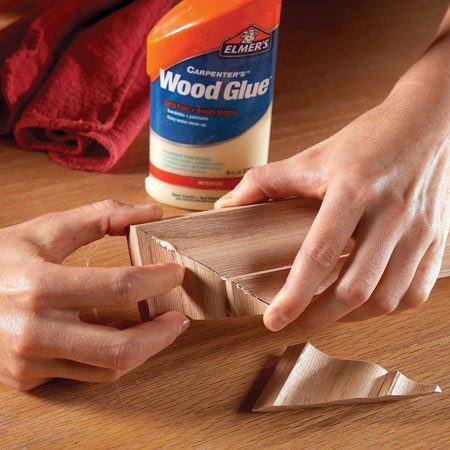 <b>Photo 4: Assemble the crown miters</b></br> Glue the crown corners together without nails or clamps. Just hold each return tightly in place for about 60 seconds. Set the completed crown aside for 20 minutes, then attach it to the cabinet.