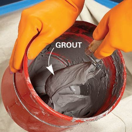<b>Let grout set, then remix</b></br> Remix the grout after letting it set for 10 or 15 minutes. Add a little water if the grout is too thick.