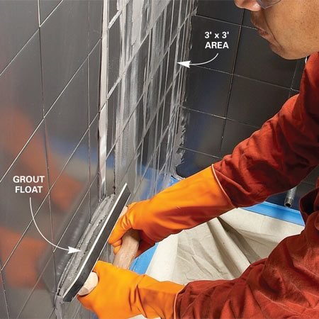 <b>Apply grout to the wall</b></br> Scoop grout from the bucket with your grout float and apply it to the wall with upward strokes. Don't worry about getting it into the joints yet.