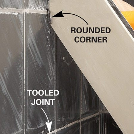<b>Shape the joints </b></br> Pull the rounded corner of the grout float over every joint to shape them.