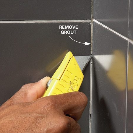 <b>Remove grout to make room for caulk</b></br> Remove grout from inside corners and along the tub to make room for caulk. Use a utility knife for narrow spaces or an old screwdriver or putty knife for wider joints.