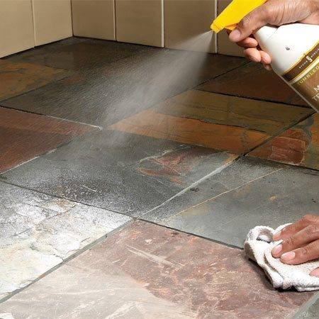 <b>Spray sealer on floor tile</b></br> Apply a thin coat of sealer to porous stone. Follow the application instructions on the label. Wipe up excess sealer with a cloth to avoid puddles. Then let the sealer dry before you grout.
