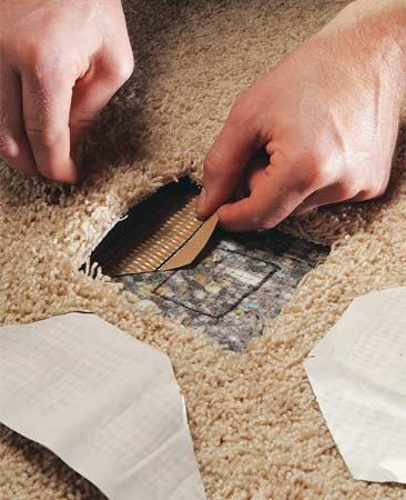 <b>Photo 4: Peel the tape backing</b></br> Peel off the tape's backing and set each piece in place, sticky side up. Don't let the super-sticky tape touch the carpet backing—or anything else—until it's in position.