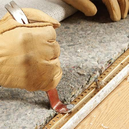 <b>Photo 2: Pull the nails</b></br> Pry up the threshold just enough to raise the nail heads. Then pull the nails and remove the threshold. Work from the carpeted side to avoid scratching the hard flooring. Nail down a new threshold.