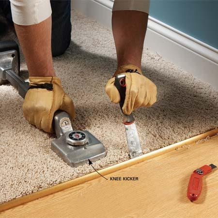 "<b>Photo 3: Kick the carpet tight</b></br> Nudge the carpet toward the threshold with a rented ""knee kicker"" and force the carpet into the threshold's teeth with a stiff putty knife.</p>"