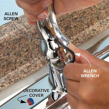 <b>Photo 1: Lift and remove the handle</b></br> Lift the handle, pry off the decorative cover with your fingernail or a flat-blade screwdriver, then loosen the Allen screw underneath and lift the handle free.
