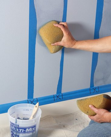 <b>Photo 4: Pounce the glaze</b></br> Pounce the flat side of a second dampened sponge between the torn edges of the tape to spread the glaze. Remove the tape and let the glaze dry.