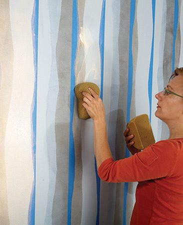<b>Photo 5: Repeat the technique</b></br> Apply masking tape for the next set of stripes. Tear the tape edges and apply the glaze using the same technique as you used for the first stripe. Remove the tape and let the glaze dry. Repeat the masking, tearing and glazing steps for the final stripe.