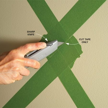 <b>Photo 2: Cut perfect corners</b></br> Create perfect corners where the squares meet. Mask around the squares, then slice off the excess tape. Use a sharp utility knife and light pressure to avoid cutting into the drywall.