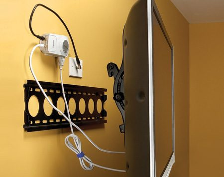 <b>Low-profile surge protector</b></br> Mount a low-profile surge protector directly behind a wall-mounted TV to hide the wires. Install the electrical outlet and coaxial cable outlet behind the TV, once you determine the best location for the wall bracket.
