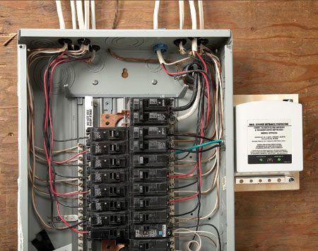 <b>Whole-house surge suppressor</b></br> Hire a licensed electrician to mount a whole-house surge suppressor on or beside the main electrical panel, as close as possible to the incoming electrical cables. This one connects to the incoming power through a dedicated circuit breaker.