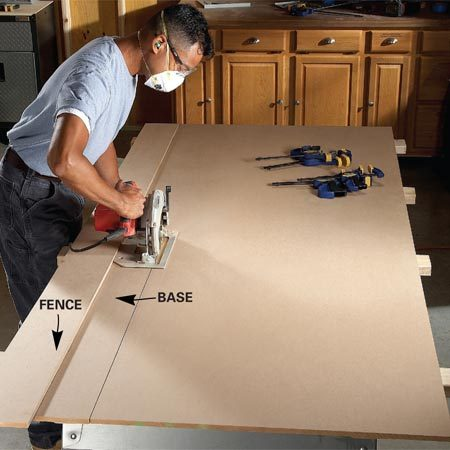 <b>Photo 2: Cut the guide</b></br> Run the saw along the fence to separate the base from the remainder of the MDF sheet. Now you have a guide that will give you perfectly straight cuts up to 8 ft. long.