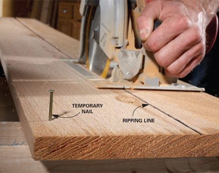 <b>Rip cut trick</b></br> In most cases, a table saw is a better choice for ripping lumber than a circular saw. But if you don't have a table saw handy, and the rip cut doesn't have to be precise, then a circular saw works fine. The trick is to hold the board in place while you rip it. Unless the board you're ripping is very wide, clamps will get in the way. So a good alternative to clamping is to tack the board down to your sawhorses. We let the nails protrude here because they don't interfere with the saw bed. But you can drive the nails (or screws) flush and still easily pull the board off when you're done. To reduce damage to better-quality boards, use finish nails, and pull them through the back side when you're done.