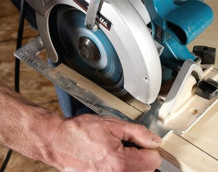 <b>Handy rip guide</b><br/>Making long narrow rip cuts with a circular saw is easy if you use your index finger as a guide. Align the blade with the line. Then pinch the saw base between your thumb and index finger and let your finger ride along the edge of the board to guide the cut. This technique is safe as long as you grip the saw before turning it on and don't release it until the blade stops.